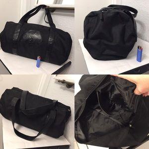 Yves Saint Laurent Bags - Yves Saint Laurent duffle bag with mini pouch