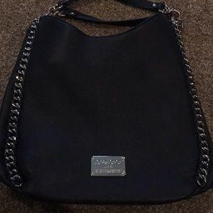 Dark Blue Bebe purse with silver chain around
