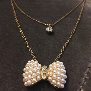 White Pearl and Gold Bow Tie Pendant Necklace