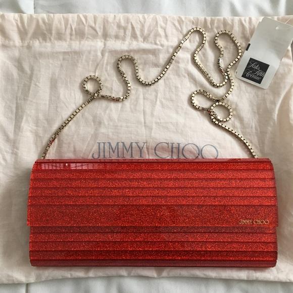 6aa48c21c6 Jimmy Choo Handbags - Jimmy Choo Sweetie Tangerine Clutch Gold Strap