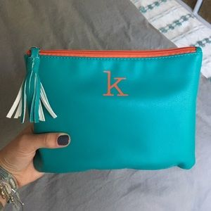 Letter 'K' turquoise Aerie pouch with tassel
