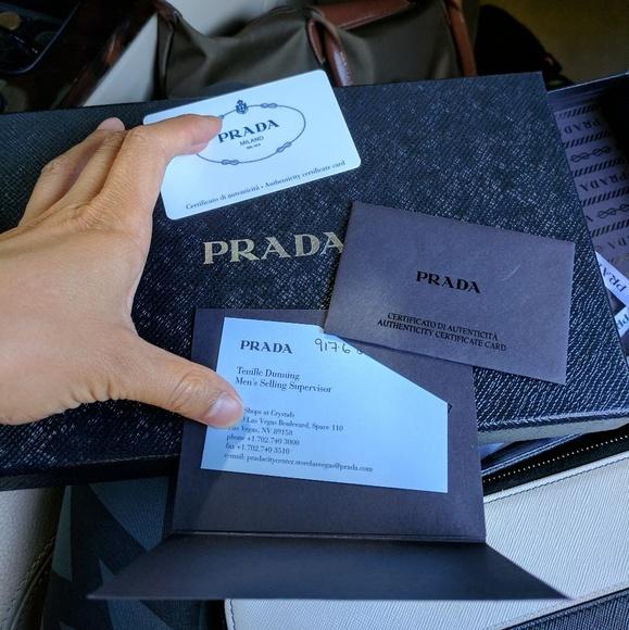 Prada Bags - NWT Prada black clutch wallet