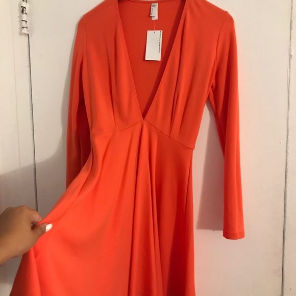 American Apparel Dresses & Skirts - American apparel, sleeved deep V racer dress. NWT