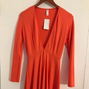 American Apparel Dresses - American apparel, sleeved deep V racer dress. NWT