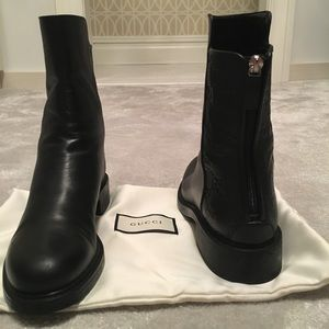 Black leather Gucci boot with embossed GG monogram