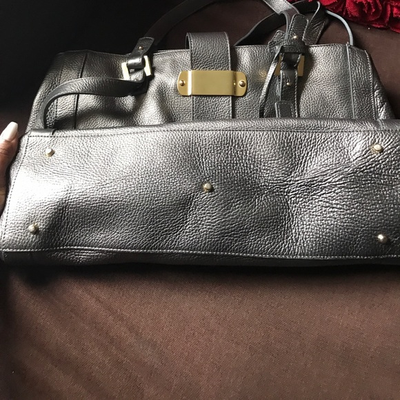 Bags - Varrlale metallic silver large hand bag.