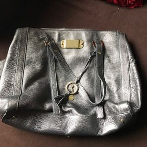Varrlale metallic silver large hand bag.