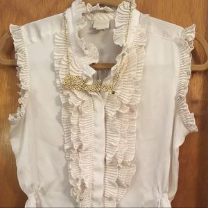 Converse creme frilly top.