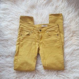 Mustard yellow skinny jeans