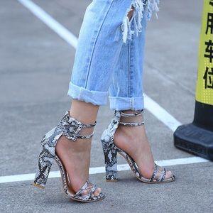 Coming soon ! Snake skin heels .