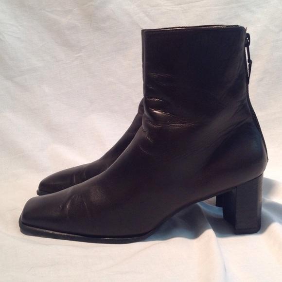 06113d64d904 M_59bc29c0291a35738d0067c2. Other Shoes you may like. Stuart Weitzman  Modest Wedge Ankle Boots Black. Stuart Weitzman ...