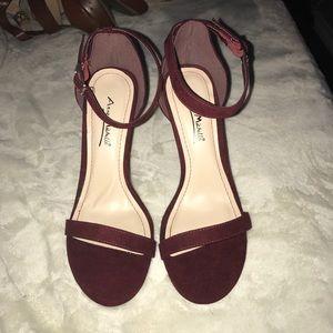 Burgundy strappy heels.