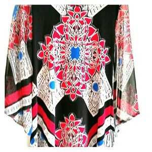 Tunic top with sheer sleeves