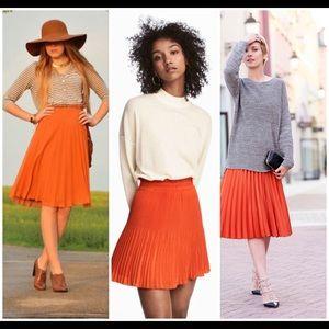 Orange acrodian pleated skirt