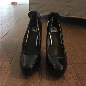 Worn... sexy black heels. Great condition.