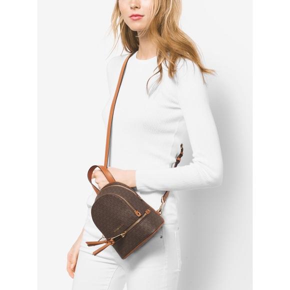 4f3da543a5fd ⚡️MICHAEL KORS Rhea Zip Extra Small Backpack. M 59bdc51a5c12f8ac13059df8