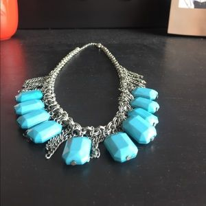 Turquoise and silver necklace.