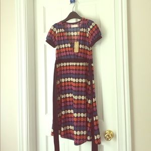 Super soft v neck dress with multi-colored dots.