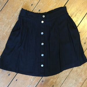 Skater skirt with decorative buttons and pockets