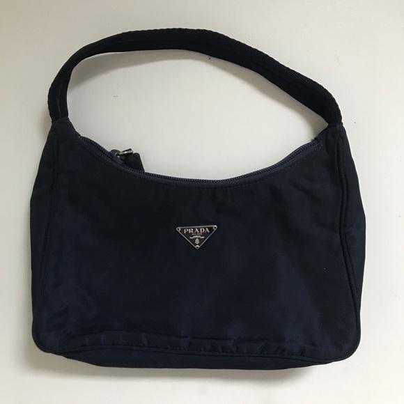 ... get prada mini nylon bag in navy 5c91d b49af aede71ee20