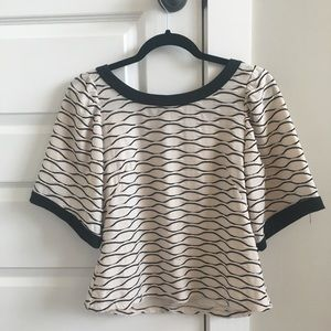 Anthropologie black and cream scalloped blouse