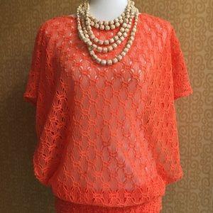 Trina Turk orange crochet top.