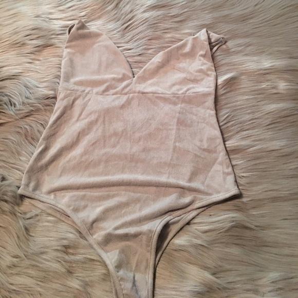 ddbd1611efd322 Gia Monae cream bodysuit. M 59bf040a5a49d0733709f073