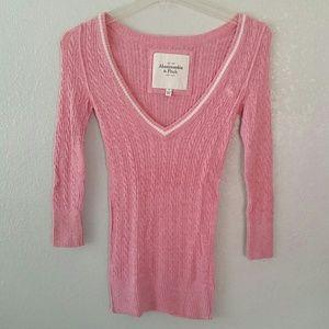 A&F pink V-neck sweater.