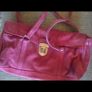 Pink suede Prada bag