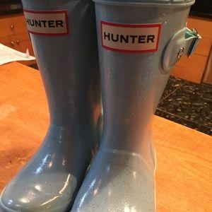 Girls Hunter rain boots.