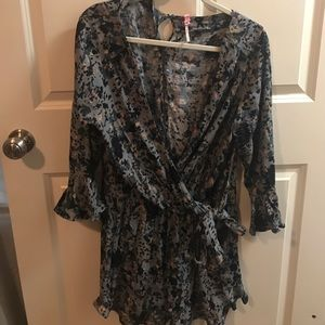 Free People romper. Deep v, and ties on the side