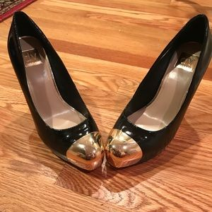 Black patent leather w/ gold tip toe
