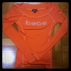 Orange long sleeved top