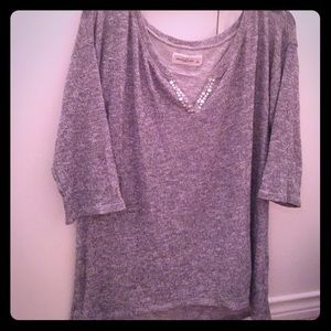 Gray glittery sweater with sequins at top.