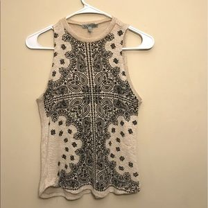 Vest style top with artistic designs