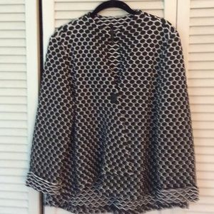 Pretty, like new, black and white top or jacket.