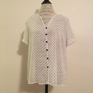 White cap sleeve blouse with black polka dots