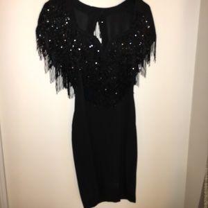 BEAUTIFUL BEADED DRESS : LOW CUT IN THE BACK