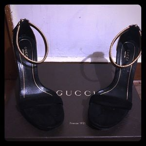 Black and gold Gucci shoes