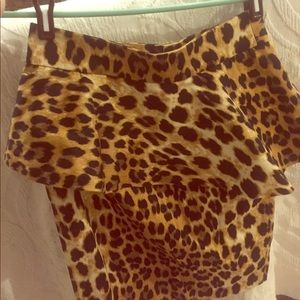 Pencil peplum leopard print skirt.