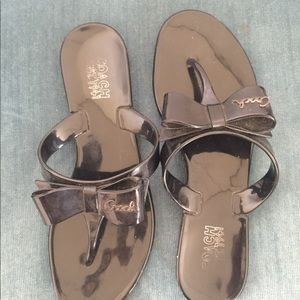Black rubber bow coach flip flops. Size 7