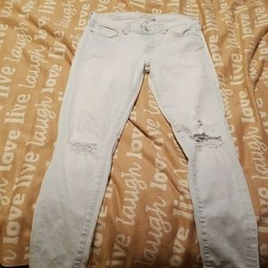 Lucky Brand distressed pale blue jeans