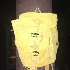 mustard yellow suede buckle backpack!