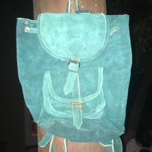 small turquoise purse/backpack