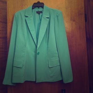 Mint green suit coat with tags still on.