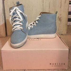 Blue denim heeled sneakers.
