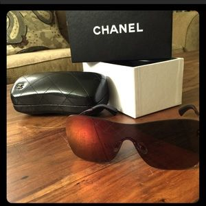 Athletic Chanel sunglasses with leather case