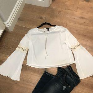 Cream bell sleeve crochet top