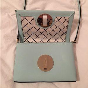 A tiffany blue kade Spade cross body mini bag.