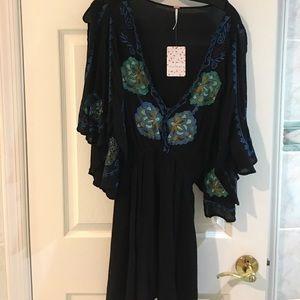 Free People black embroidered mini dress.